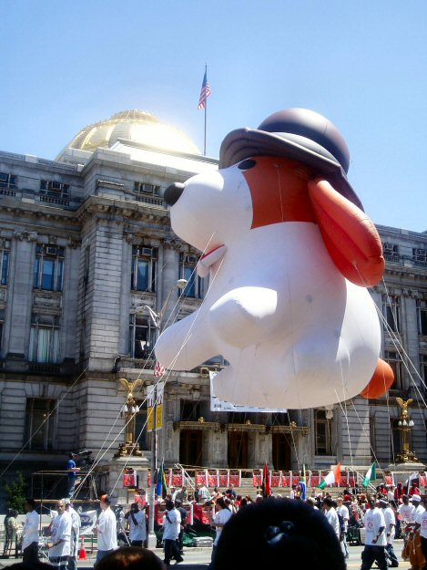 "[Giant balloon of ""Growl"" the dog on parade]"
